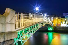 The ha`penny bridge in Dublin. DUBLIN, IRELAND - FEBRUARY 20, 2012: The ha`penny bridge in Dublin at night, Ireland. Dublin is the capital and largest city of Stock Images