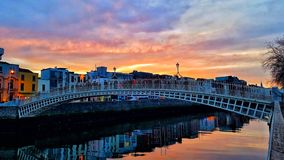 HaPenny Bridge. The famous HaPenny footbridge, over the river Liffey at Sunset, on a cold December evening in Dublin city, Ireland Stock Photo