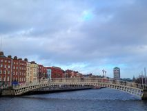 Ha`penny Bridge with Georgian architecture Dublin Ireland. This is a picture of the Ha`penny Bridge, Dublin, Ireland. With the river Liffey, showing the Georgian royalty free stock image