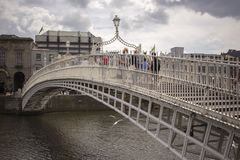 Ha`penny Bridge over Liffey river in Dublin, Ireland Stock Photos