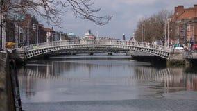 Ha`Penny bridge over River Liffey in Dublin city, Ireland stock image