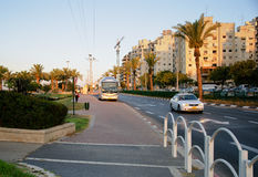 City bus stop area at sunset. Rishon Le Zion, Israel - August 6, 2013: Ha-Sitvanit bus stop area at sunset in Golda Meir Street in Rishon Le Zion, Israel Stock Photo