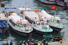 Ha Trang, Vietnam - July 13, 2015: Nha Trang, Vietnam - July 13, 2015: Boats are mooring at the docks Royalty Free Stock Images