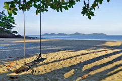 Haad Farang beachon Mook island early in the morning with Kradan island in the background Royalty Free Stock Photo