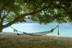 Haad sai khao. Atmosphere at area of Haad Sai Khao, Tarutao National Marine Park which has hammock under the tree, shallow focus Royalty Free Stock Photo