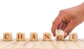 Haal voordeel uit kansen die verandering te bewerkstelligen wordt voorgesteld met dobbelen voor witte achtergrond stock fotografie