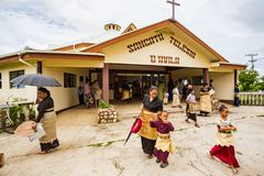 Polynesian parishioners in traditional Tongan dress walk out of church as Catholic Mass ends, Haapai, Tonga, Polynesia. royalty free stock photo