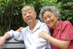 A haappy senior couple. An intimate senior couple in a garden Stock Photos