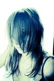Haar über dem Gesicht eines Mädchens Stockfotos
