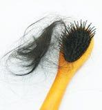 Haarbürste mit dem verlorenen Haar Stockbilder