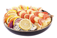 Haarder stuffed baked with potatoes and tomatoes Stock Images