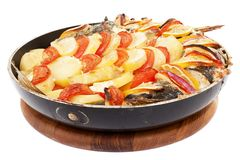 Haarder stuffed baked with potatoes and tomatoes Stock Photo