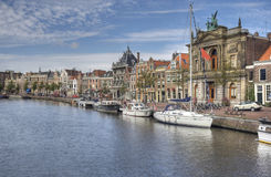 Haarlem, Holland. Canal with boats and historical houses in Haarlem, Holland Stock Photography