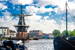 Haarlem Netherlands. HAARLEM, NETHERLANDS - 11 May 2014. Scenic Spaarne River and the city on 11 May in Haarlem, Netherlands Royalty Free Stock Images