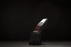 Haartrimmer vor einem schwarzen Hintergrund Lizenzfreies Stockfoto
