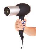Haartrockner in der Hand Stockbild