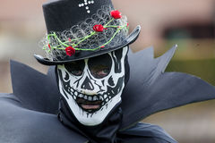 Costumed participant of Fantasy Fair wears skull mask Royalty Free Stock Photos