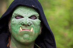 Man with green mask impersonates ork at Fantasy Fair Royalty Free Stock Image