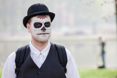Man with skull painted on his face participates in Fantasy Fair Royalty Free Stock Image
