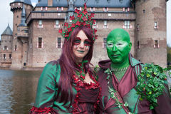Man and woman in fantasy outfit posing at Haarzuilens Castle Royalty Free Stock Images