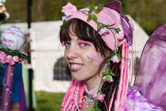 Pink scarfed woman dressed up for Fantasy Fair Stock Photography