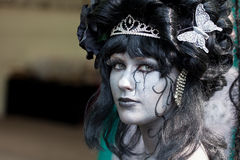 Silver painted lady dressed up as witch at Fantasy Fair Royalty Free Stock Photos