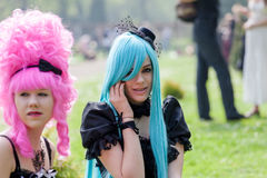 Two women with colorful wigs at the Fantasy Fair Stock Image