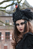 Woman in black dress participates in Fantasy Fair Stock Images
