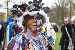 Woman with painted face and colorful outfit participates in Fantasy Fair Stock Images