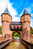 Gate and Bridge over the Moat of Castle De Haar, a 14th century Castle rebuild in the late 19th century stock photography