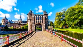 Gate and Bridge over the Moat of Castle De Haar, a 14th century Castle rebuild in the late 19th century stock photo