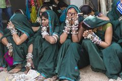 Tribal girls in Bhagoriya. At Haat Festival tribal you can also see some people with their traditional dresses and ornaments. Males play flute and dhol drums and Stock Photo