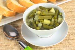 Haba verde y patata Hotpot Imagenes de archivo