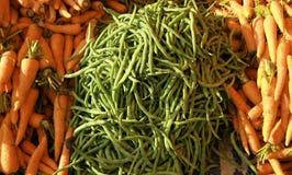 Haba verde y zanahoria Fotografía de archivo