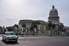 Habana capitolio. Cuba's capitol, with an old car royalty free stock image