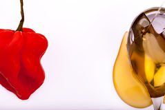 Habanero chili pepper and honey Royalty Free Stock Photo