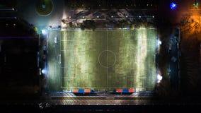 Habarovsk 夜泛光灯的体育场在草发光 免版税图库摄影