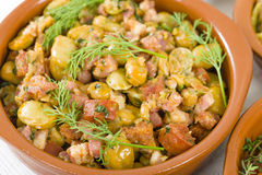 Habas Con Chorizo. Broad beans with chorizo and serrano ham. Traditional Spanish tapas dish Royalty Free Stock Images