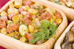 Habas Con Chorizo. Broad beans with chorizo and serrano ham. Traditional Spanish tapas dish Royalty Free Stock Photo