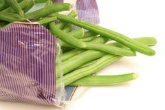 Habas verdes en bolso en cara Foto de archivo libre de regalías