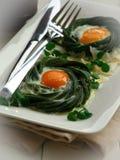Habas verdes y huevos cocidos al horno Imágenes de archivo libres de regalías