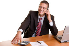 Habby businessman in office makes telephone call royalty free stock images