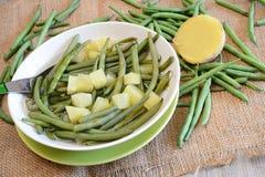 Habichuelas verdes y patatas Imagen de archivo