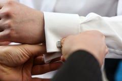 Habillage du marié Photo stock