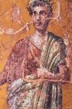 Habillement ? Rome antique, figure d'un homme romain peint dans un fresque dans un Domus de Pompeii image libre de droits