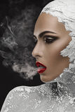 Habit and aftermath. Beautiful and well-groomed woman smoking a cigarette, a habit Stock Images