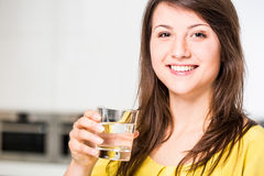 Habit of drinking water. Young woman with healthy habit of drinking water stock photography