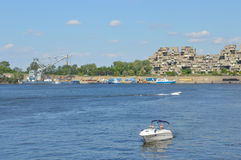 Habitat 67 Apartments and a boat in old port People may be seen around. stock images