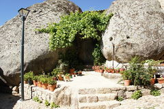Habitation with boulder in Monsanto, Portugal Stock Image
