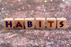 Habits word. Wood Cubes Habits word on glitter background Stock Photo